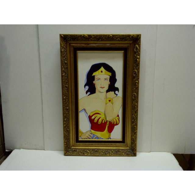"This is an original painting on canvas, titled ""Wonder Woman"" By Sam Thorp. The painting is framed in a nice ornate frame..."
