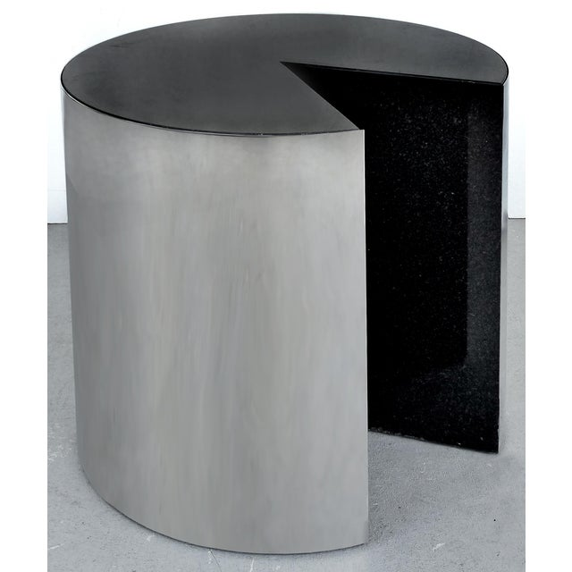 Offered for sale is a pair of side table by the Pace Collection. A pair of stainless steel cylindrical tables with inset...