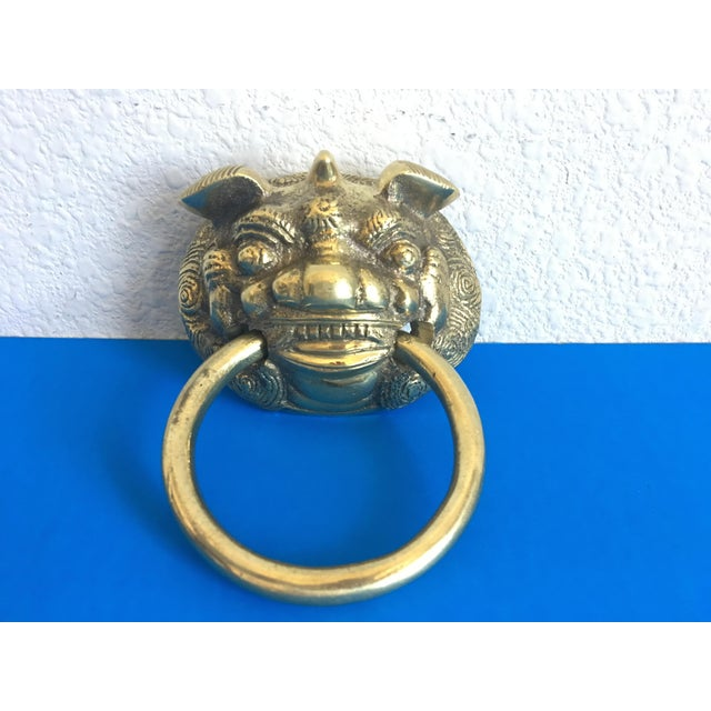 Add chic chinoiserie style to your front door with this heavy midcentury brass door knocker featuring a fabulous, highly...