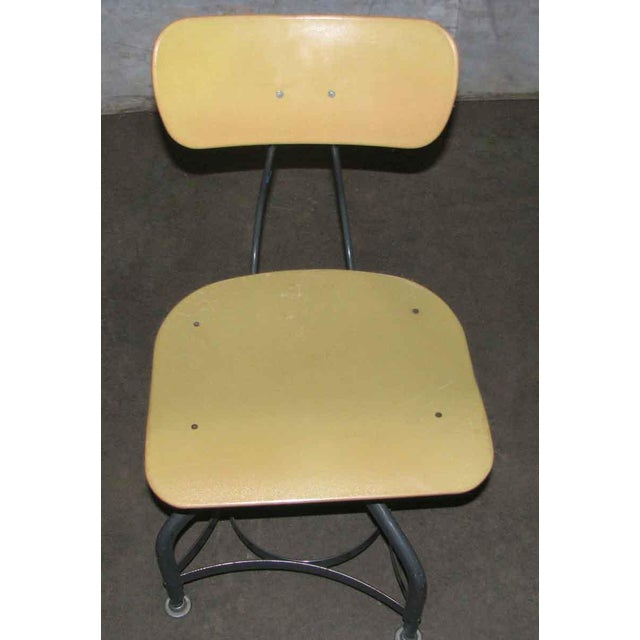 Mid-century factory stool with adjustable height chair.