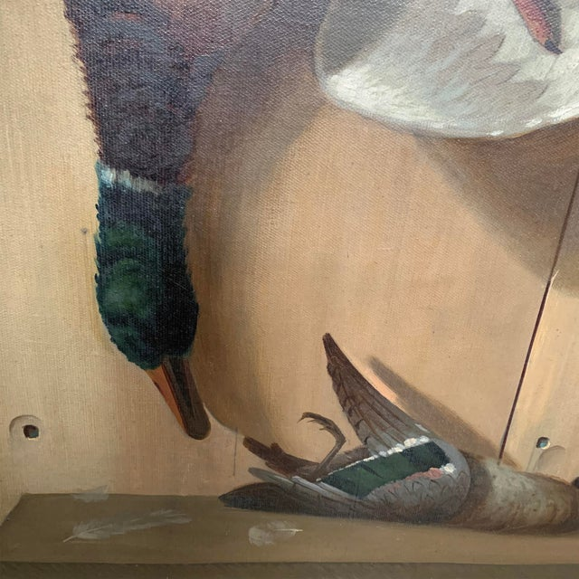 A wonderful 19th century American oil on canvas trompe l'oeil hunt painting depicting a large mallard duck hanging by a...