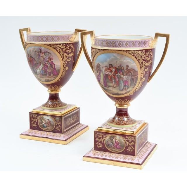 Antique hand painted pair of Royal Vienna porcelain uncovered decorative piece / urn. Each piece have two gilt side...