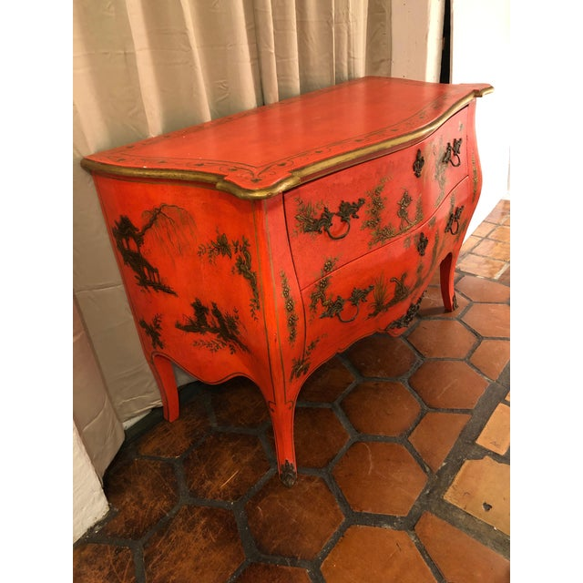 A show stopper 1940s Italian bombe style large commode in a fantastic shade of bright coral having gilded chinoiserie...