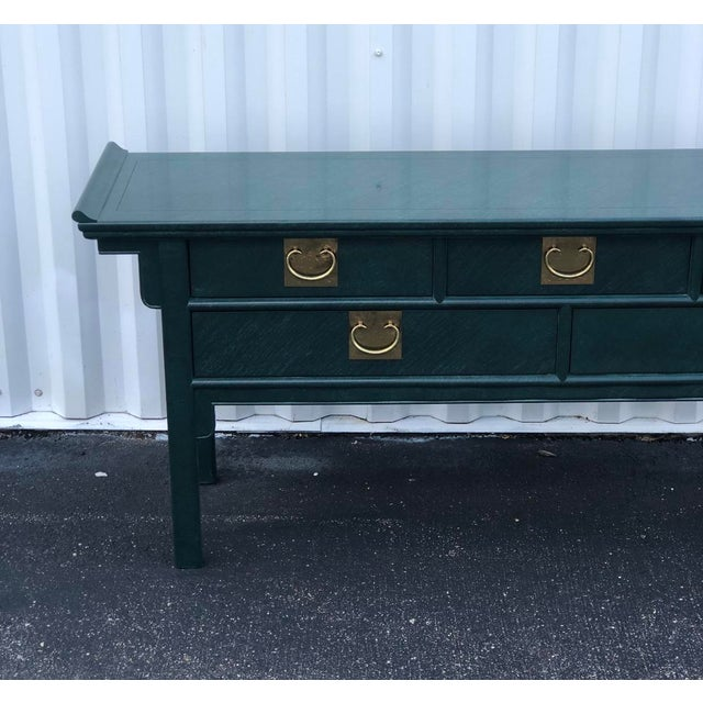 Spectacular vintage Century pagoda console table in original malachite green lacquer. Chunky brass hardware