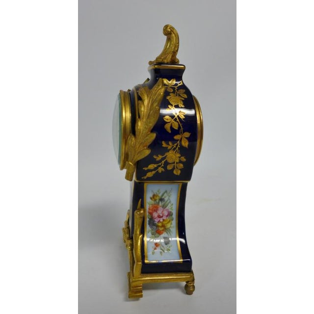 Porcelain and doré bronze mounted Continental Clock. Loius XVI style. Figural and floral painted scenes. Features open...