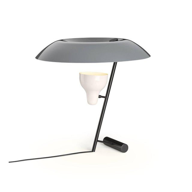 *NOTE: 3-4 WEEK LEAD TIME* Gino Sarfatti model #548 table lamp in gray and burnished brass. Designed in 1951, this is an...