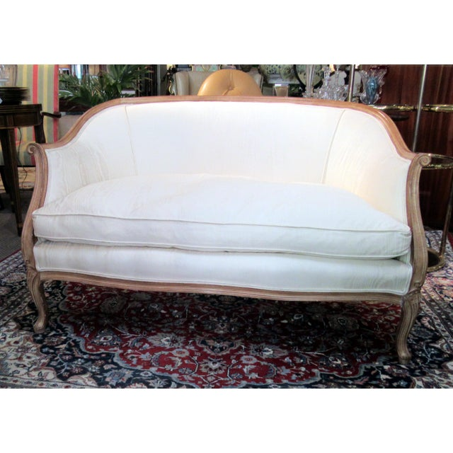 This Country French Style Settee in a soft off white fabric is simple and pretty. It is very comfortable with the down-...
