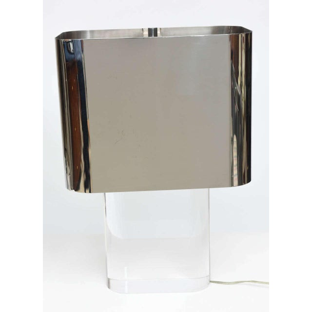 The chrome shade with rounded edges over a chunky Lucite base provenance ex collection Howard Rothberg, Karl Springer...