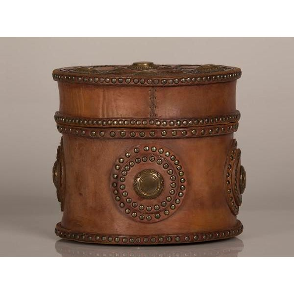 A large round antique Italian leather box circa 1900. Please look at the intriguing circular shape to both the top and the...