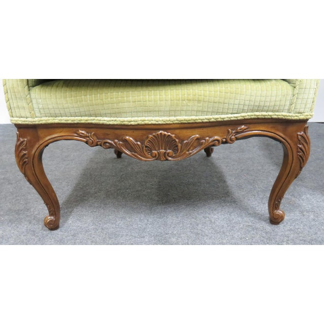 A pair of custom made Louis XV style club chairs, carved fruitwood frames, light green upholstery