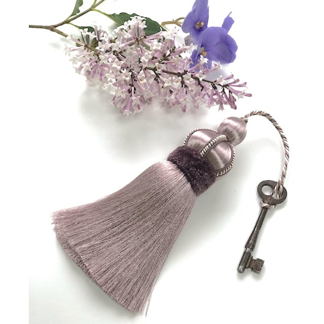 One lavender colored key tassel with hand cut velvet ruche, decorative gimp and twisted cord detail. Total height, per...