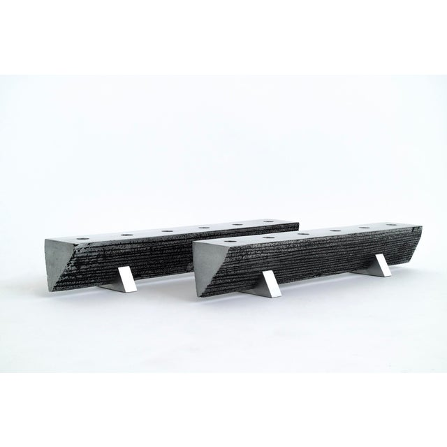 Brutalist candelabras. Striated texture, black patinated impressions, six candle wells, beveled angle edges with...