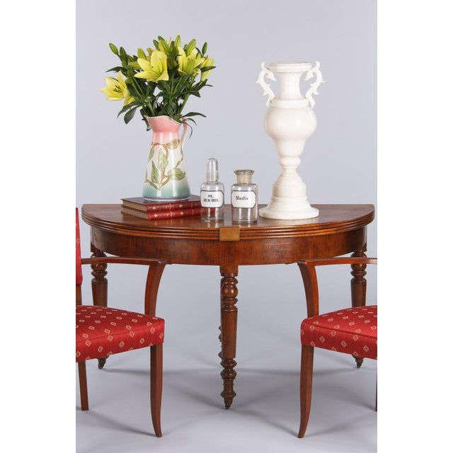 """A beautiful period Louis Philippe demi lune table in French blond walnut that opens up to a round table of 50.75""""..."""
