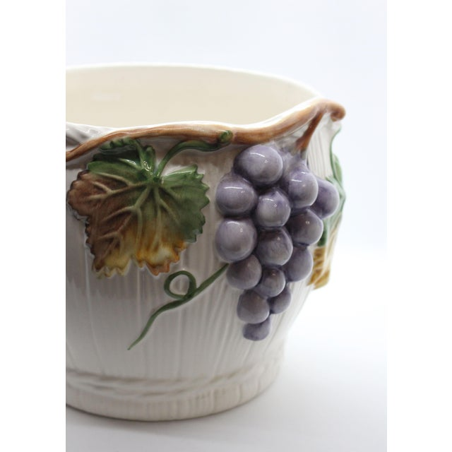 Maker's mark on bottom: Alcobaça, Portugal. A beautiful piece of hand-glazed porcelain with a grape vine in repouseé...