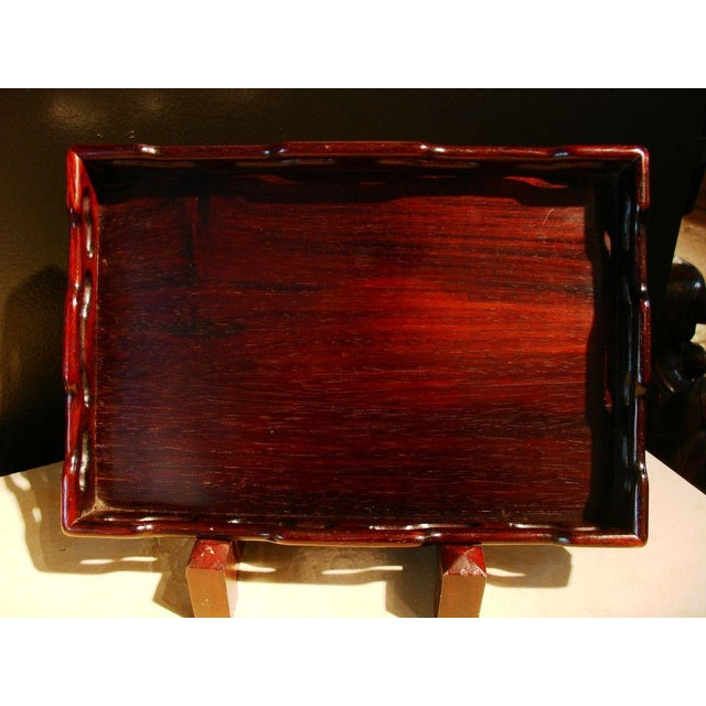 """A refined and elegant pair of huanghuali nesting trays. An exotic hardwood, huanghuali (which translate to """"yellow..."""
