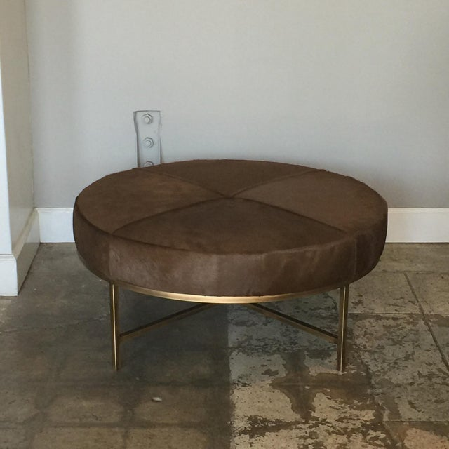 Medium 'Tambour' antiqued brass and hide ottoman by Design Frères. Upholstered firm, so also great as a coffee table, with...