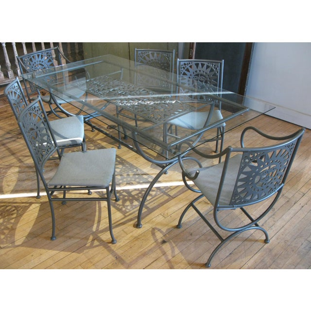 A vintage 1960s dining set designed by Arthur Umanoff, with frames in aluminum and seat backs and the table base with...