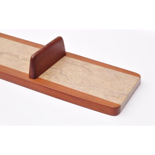 Marble platter with teak frame on two footing. The length of the platter allow excellent surface use for tasty tidbits....