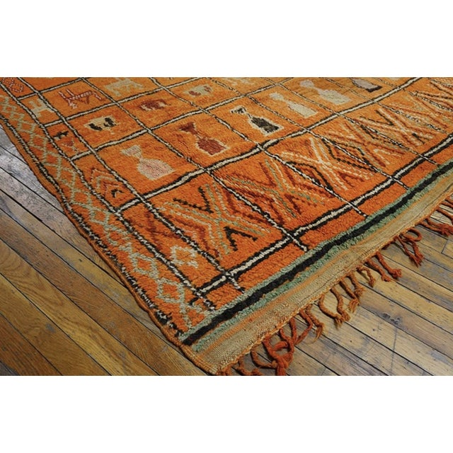 Antique Moroccan Rug with an orange background.