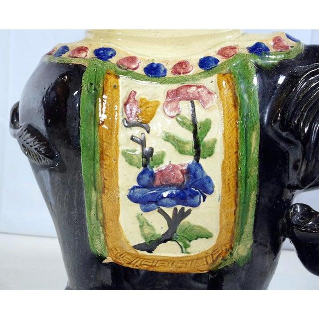 Vintage ceramic elephant occasional table with black glazed body.