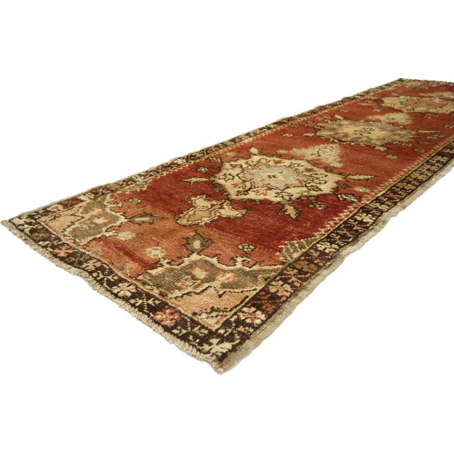 51398, a vintage Oushak rug runner. This exquisite runner features three central medallions outlined in stark contrasting...