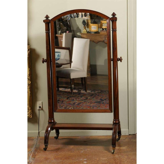 A Scottish mahogany free standing cheval mirror from the early 19th century. Born in Scotland circa 1820, this piece...