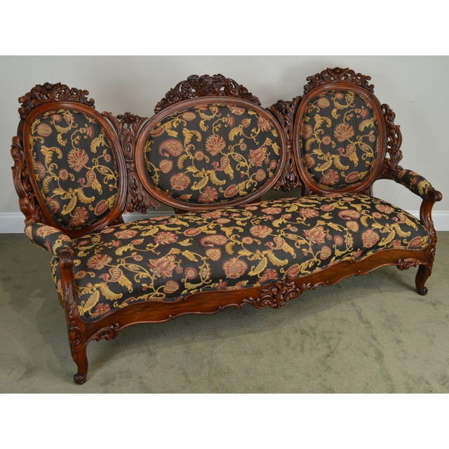 High quality finely carved rosewood, rococo revival sofa.~ Unsigned maker - of the era and quality of 'J.W. Meeks' and...