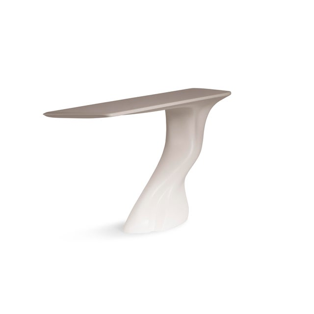 Frolic console table is a stylish futuristic sculptural art table with a dynamic form designed and manufactured by Amorph....