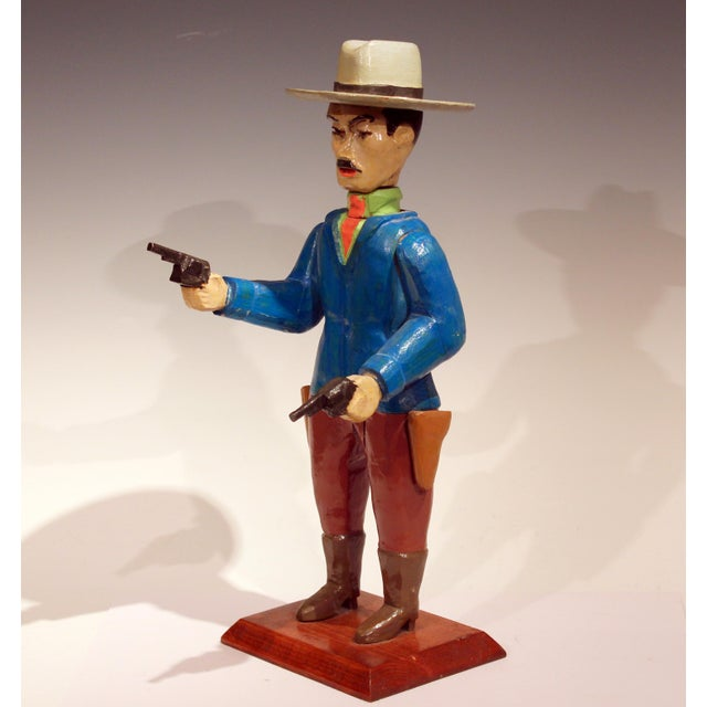 Vintage folk art carved and painted figure of a mustachioed gunslinger in coat and tie, with a flat brimmed hat. Not sure...