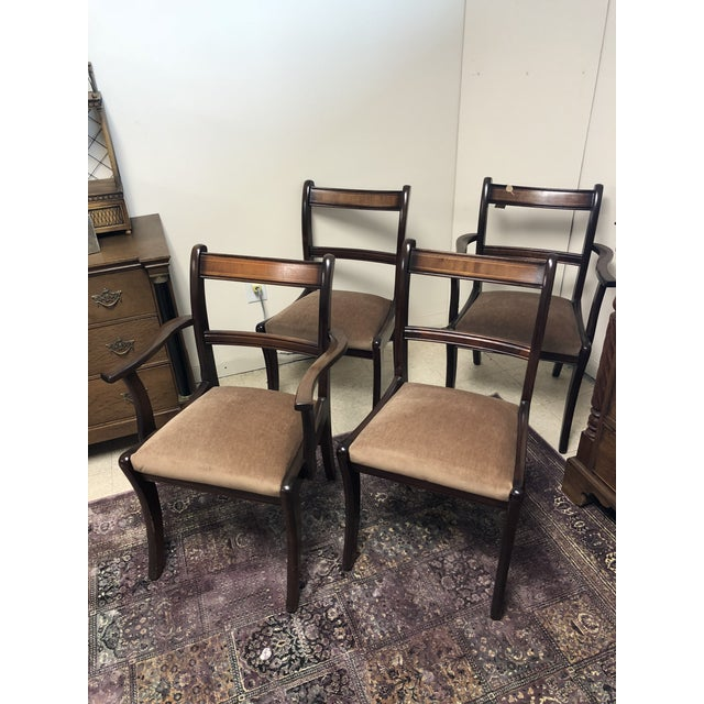 Set of 4 antique Mahogany with walnut inlay dining chairs that includes: 2 armchairs and 2 regular chairs. The set is very...