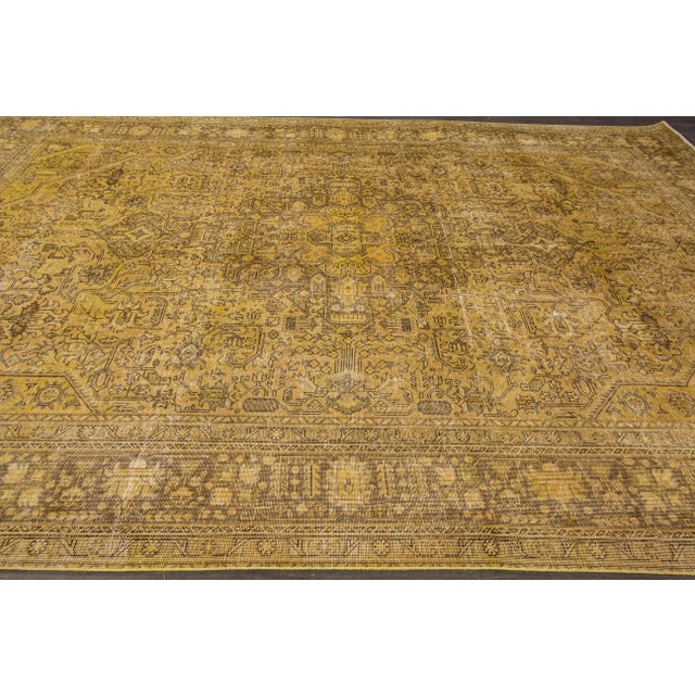 Hand-knotted rug with a medallion design on a yellow field. This rug has magnificent detailing and would be perfect for...