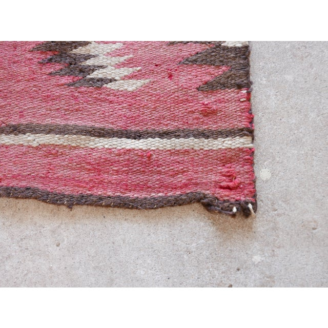 Antique Kilim featuring great colors and minor wear consistent with age.