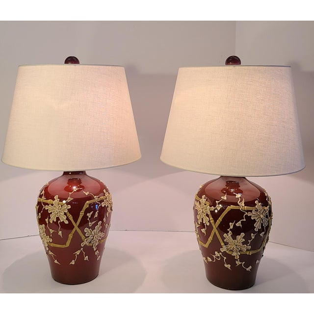 """Japanese Moriage style painted lamps with bamboo and Chrysanthemum flower detail. Paired with 16"""" white linen shades and..."""