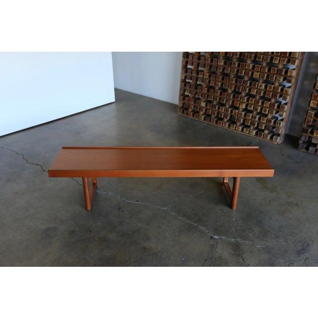 "Teak ""Krobo'' bench by Torbjørn Afdal for Bruksbo with original labels. This piece has been professionally restored."