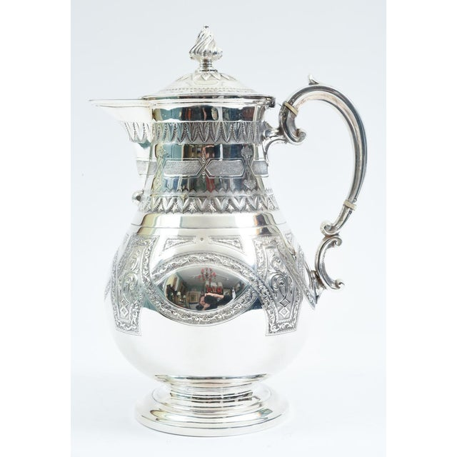 English silver plate tea or coffee pot with exterior design details. The tea or coffee pot is in excellent condition,...