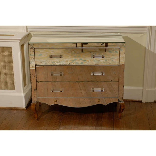 Beautiful French mirrored three (3) drawer chest/commode in the Jansen style, circa 1940. Completely original with all...