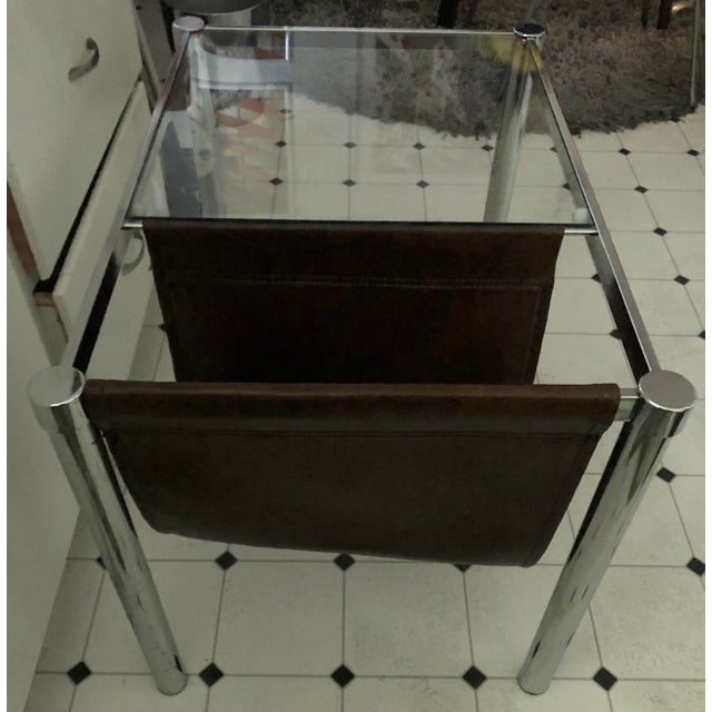 Mid-Century Modern Era Milo Baughman for DIA Style Chrome and Glass top Side Table with Leather Magazine rack. Chrome and...