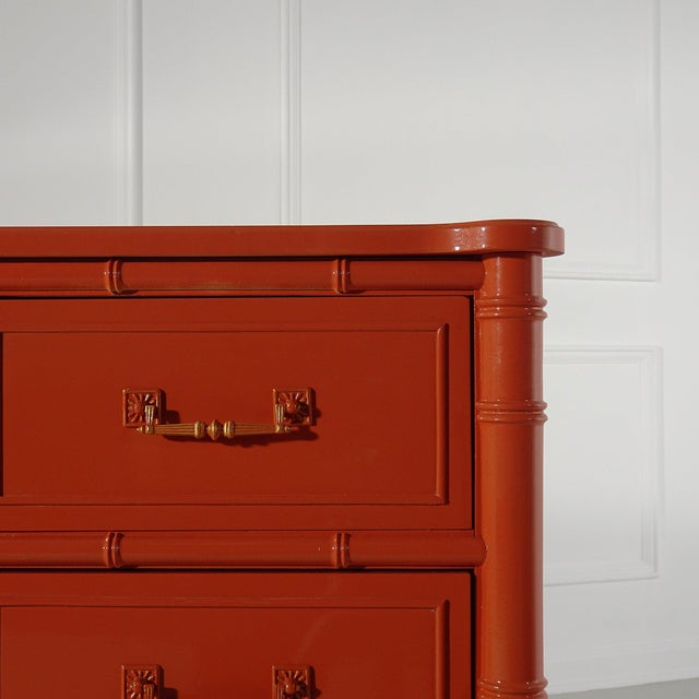 Henry Link Bali Hai 6 drawer dresser lacquered in a fiery orange. Faux bamboo details. Hardware refinished in fiery orange...