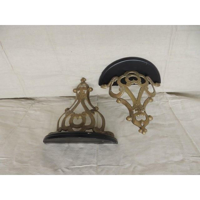 Pair of Vintage Brass and Wood Plate Holding Brackets Demi Lune shape on the top of the brackets. Brass motifs underneath...