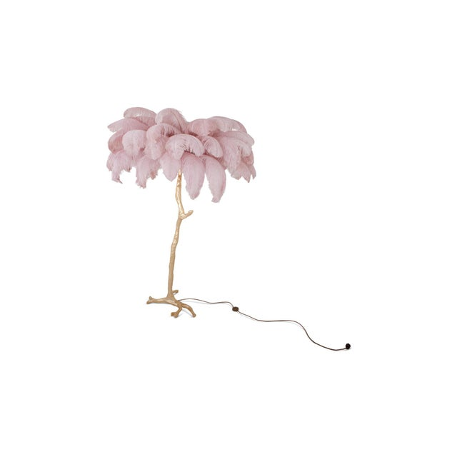 Golden Palm tree floor lamp with pink feather foliage. The top comes with dyed Ostrich feathers with a golden or brass...