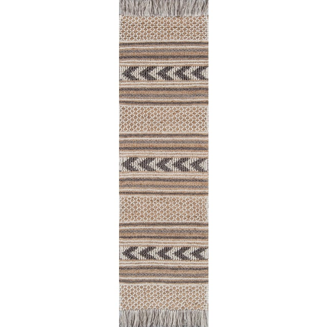 Humble materials meet high-fashion aesthetic in the luxe fabrication of this modern area rug collection. The inspired...