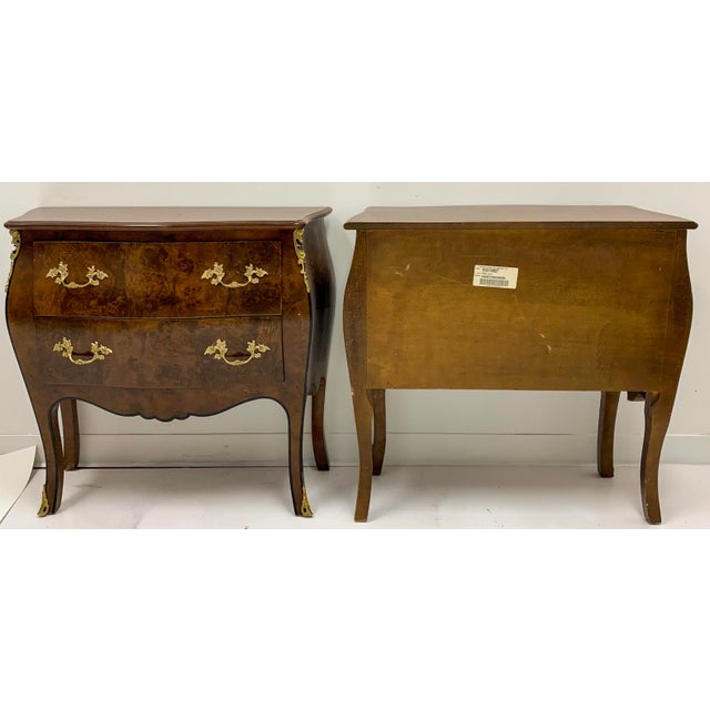 This is a pair of burl wood serpentine bombe chests by Hekman Furniture. The drawers are lined with paper, and they have...