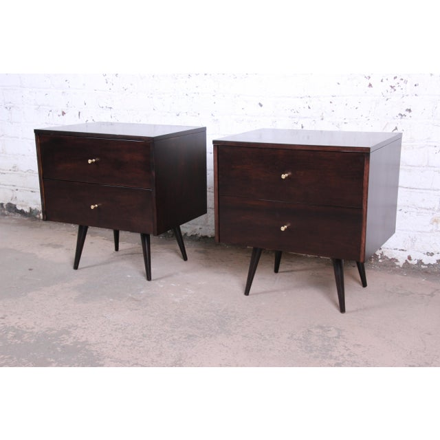 An exceptional pair of mid-century modern nightstands designed by Paul McCobb for his Planner Group line for Winchendon...