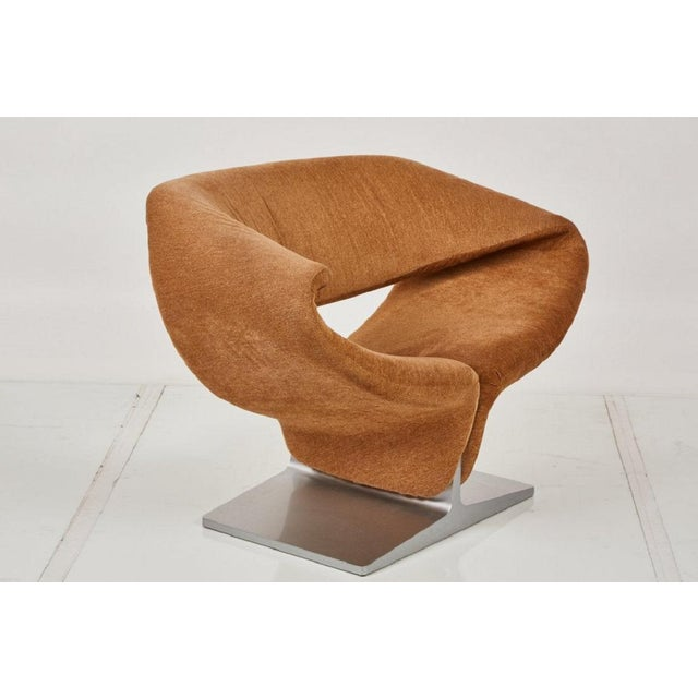 Ribbon chair and matching ottoman designed by Pierre Paulin for Artifort in camel upholstery.
