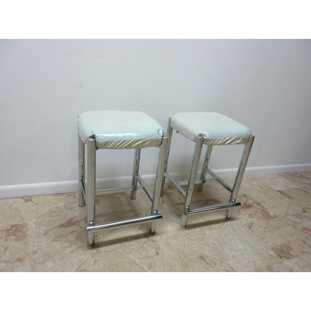 A paid of Mid-Century style chrome counter bar stools. Great shape. Tight and sturdy.. Minor wear and a few scratches.....