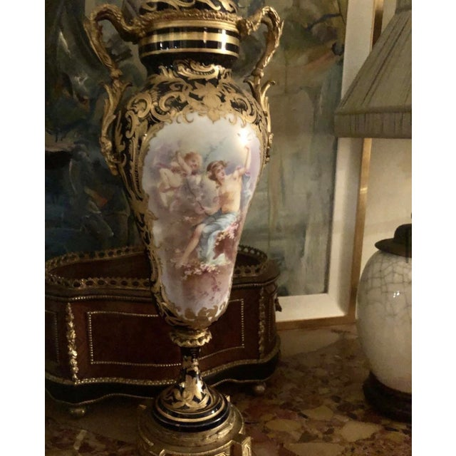 A late 19th century Sevres porcelain and gilt bronze mounted covered cobalt blue vase with raised gilt design and foliate...