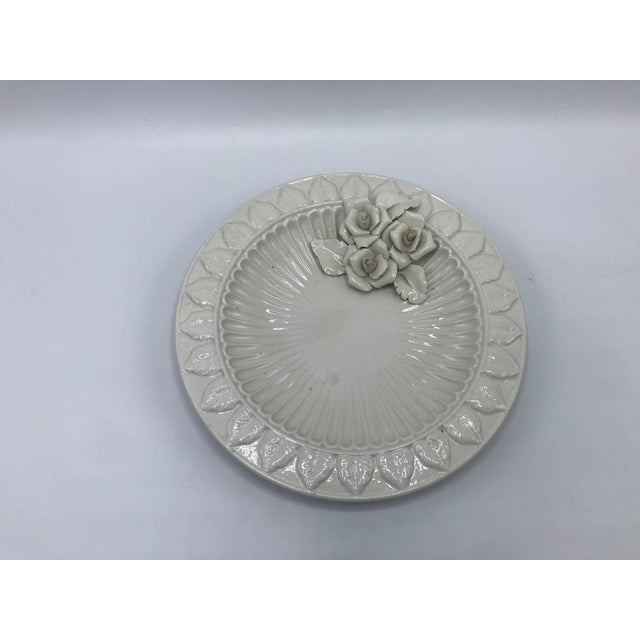 Offered is a fabulous, 1970s Italian ceramic plate. The piece has a stunning sculptural rose bouquet motif and a raised...