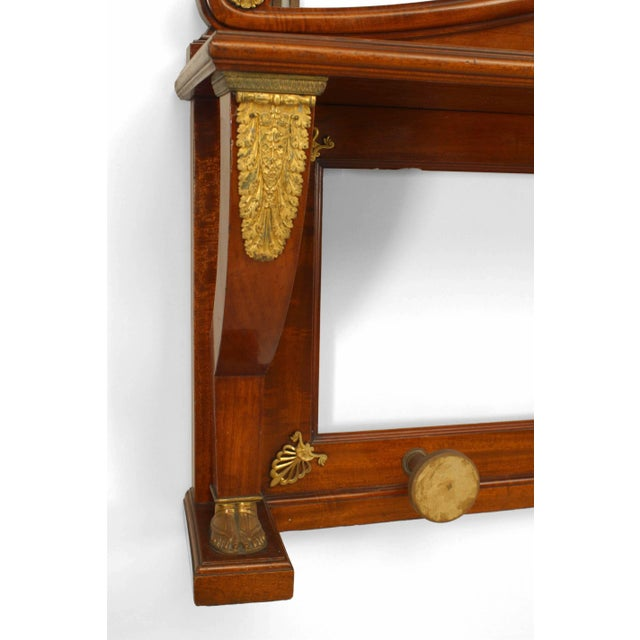 French Empire style horizontal mahogany and bronze trimmed wall hatrack with mirror under a shelf (19th Century).
