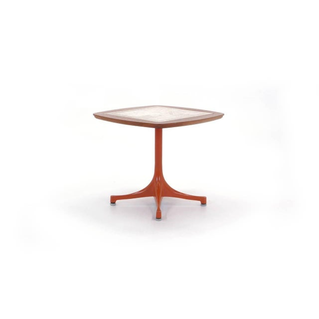 Rare version of the George Nelson for Herman Miller Swag Leg side table. All original orange base with travertine and teak...
