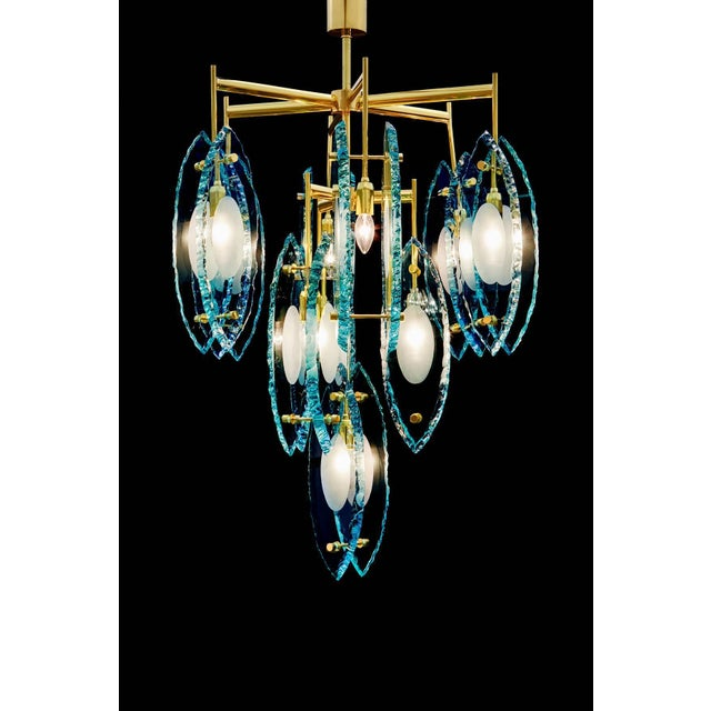 Limited edition Italian chandelier with thick etched glasses, mounted on polished brass frame / Exclusively designed by...
